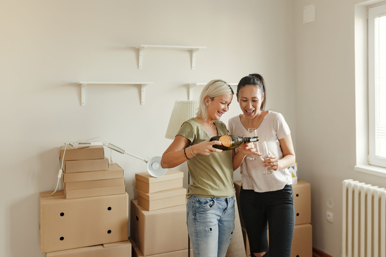 Happy Couple Celebrates Moving Into a New Apartment