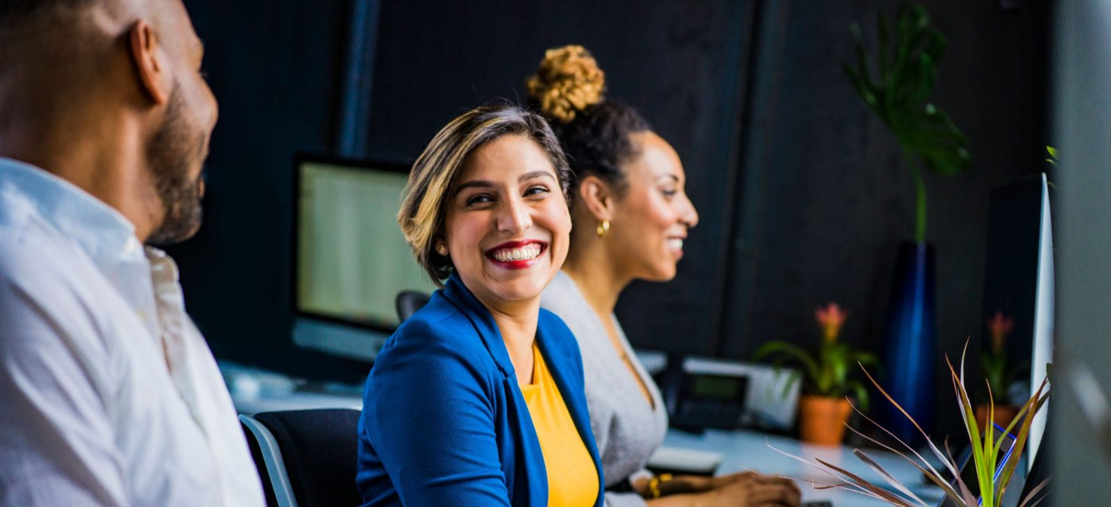 Smiling employee looking at colleague
